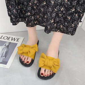 A Butterfly Pair of Flat Bottomed Female Slippers